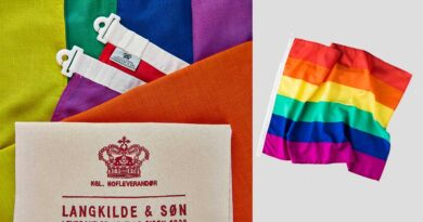 Vind ikonisk regnbueflag i ægte flagdug